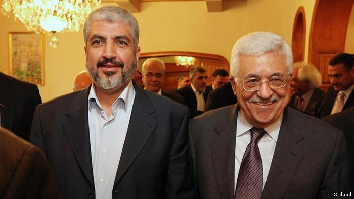 In this photo provided by the office of Khaled Meshaal, Palestinian Hamas leader Khaled Mashaal, left, and Palestinian President Mahmoud Abbas are seen together during their meeting in Cairo, Egypt, Thursday, Nov. 24, 2011. The long-estranged leaders of the two rival Palestinian political movements said Thursday they significantly narrowed differences and opened a new page in relations in reconciliation talks in Cairo. (Foto:Office of Khaled Meshaal/AP/dapd) EDITORIAL USE ONLY, NO SALES