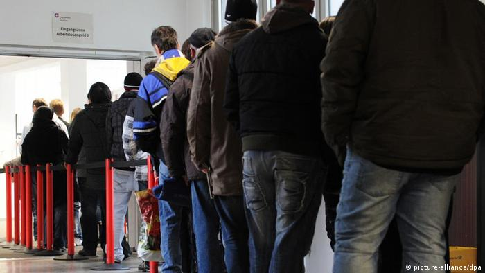 Jobseekers stand on line in the German city of Gelsenkirchen