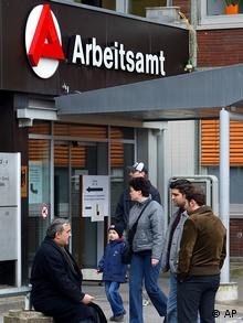 Unemployed waiting in line at German employment agency