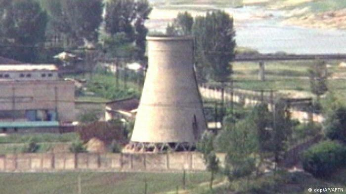 This image from television shows the demolition of the 60-foot-tall cooling tower at its main reactor complex in Yongbyon North Korea Friday June 27, 2008. 8Photo: AP)