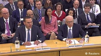 News International Chairman James Murdoch (front L), and his father Rupert Murdoch, are seen appearing before parliamentarian in London in this July 19, 2011