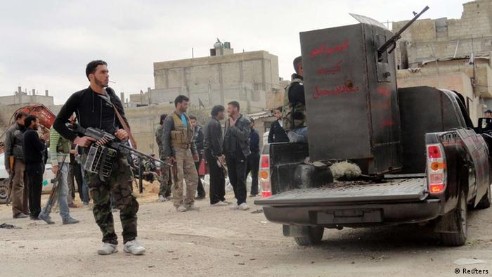 Members of the Free Syrian Army are seen deployed in al-Bayada, Homs
