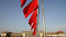 BEIJING, CHINA - MARCH 8: Red flags flutter in front of the Great Hall of the People where the second plenary session of the National People's Congress (NPC), or parliament, was held on March 8, 2005 in Beijing, China. Delegates of the NPC discussed the draft of the anti-secession law on March 8. China made clear it reserves the right to use force against Taiwan while reiterating that 'one country, two systems' was its basic approach as it outlined its anti-secession law aimed at the island. (Photo by Andrew Wong/Getty Images)