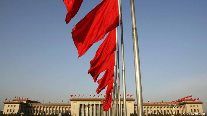 Red flags flutter in front of the Great Hall of the People where the second plenary session of the National People's Congress (NPC), or parliament, was held on March 8, 2005 in Beijing, China. (Photo by Andrew Wong/Getty Images)