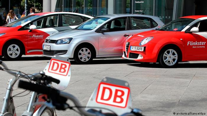 Parked cars and bicycles that are part of the Deutsche Bann Flinkster car and bike sharing program