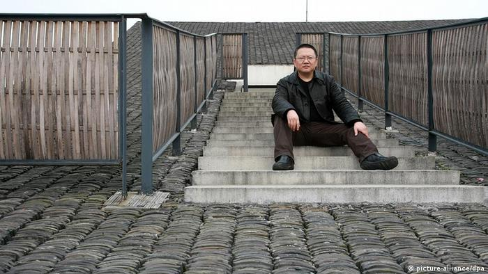 Chinese architect Wang Shu, owner of the Amateur Architecture Studio, poses on the roof of an architecture he designed at the Xiangshan campus of China Academy of Art in Hangzhou (Copyright: dpa)