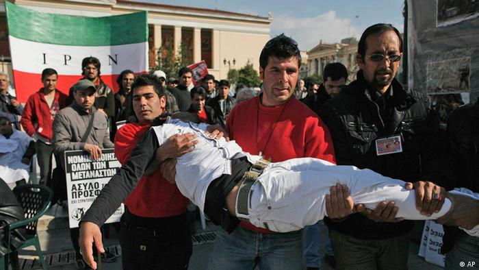 An Afghan immigrant with his lips sewn shut, is carried after collapsing during an one-month hunger strike in Athens, Thursday, Jan. 27, 2011 (AP Photo/Alkis Konstantinidis)