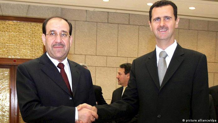 Iraqi Prime Minister Nuri al-Maliki (L) meeting Syrian President Bashar al-Assad