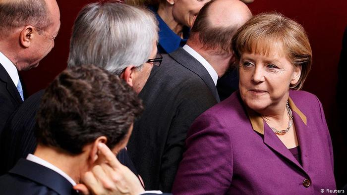 (L-R) France's President Nicolas Sarkozy, Luxembourg's Prime Minister Jean-Claude Juncker and Germany's Chancellor Angela Merkel