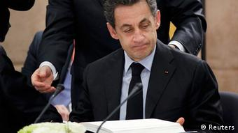 France's President Nicolas Sarkozy signs a fiscal compact enshrining common debt rules among the 17 members of the euro zone during a European Union leaders summit in Brussels March 2, 2012 . REUTERS/Francois Lenoir (BELGIUM - Tags: POLITICS BUSINESS)