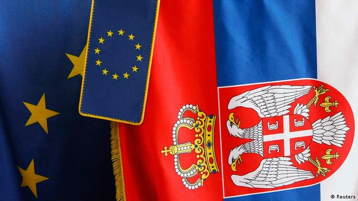 European Union flags are seen together with Serbian flag in a flags-selling shop in Belgrade February 28, 2012. EU foreign ministers were discussing on Tuesday whether to recommend Serbia as an official candidate for the membership in the bloc , but a final decision could be taken at a summit of EU leaders on Thursday and Friday. REUTERS/Ivan Milutinovic (SERBIA - Tags: SOCIETY POLITICS)