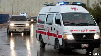 A convoy of Lebanese Red Cross ambulances escorted by Lebanese police vehicles (Photo:Hussein Malla/AP/dapd)