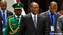 Ivory Coast President Alassane Ouattara arrives for a meeting of the Economic Community of West African States (ECOWAS) in Nigeria's capital Abuja.