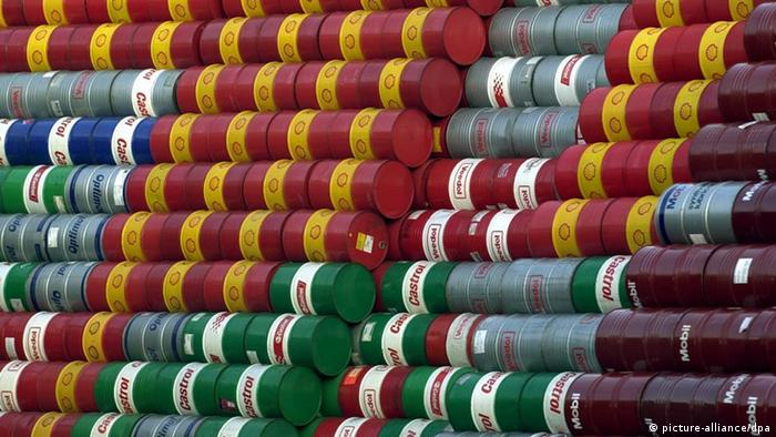 Oil barrels in Hamburg await cleaning and re-use, stacked in a huge pile. (Photo via dpa)