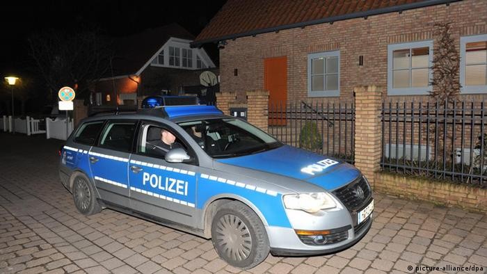 A police car in front of the Hanover home of former German President Christian Wulff