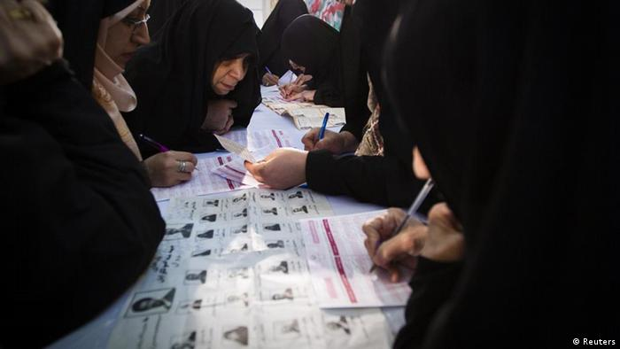 EDITORS' NOTE: Reuters and other foreign media are subject to Iranian restrictions on leaving the office to report, film or take pictures in Tehran. Women fill up their ballot papers during the parliamentary election at a mosque in southern Tehran March 2, 2012. Iranians voted on Friday in a parliamentary election which is expected to reinforce the power of the clerical establishment of Supreme Leader Ayatollah Ali Khamenei over hardline political rivals led by President Mahmoud Ahmadinejad. REUTERS/Raheb Homavandi (IRAN - Tags: POLITICS ELECTIONS TPX IMAGES OF THE DAY)