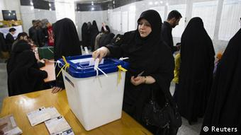EDITORS' NOTE: Reuters and other foreign media are subject to Iranian restrictions on leaving the office to report, film or take pictures in Tehran. A woman casts her ballot during Iran's parliamentary election at a mosque in southern Tehran March 2, 2012. Iranians voted on Friday in a parliamentary election likely to reinforce Supreme Leader Ayatollah Ali Khamenei's power over rival hardliners led by President Mahmoud Ahmadinejad. REUTERS/Raheb Homavandi (IRAN - Tags: POLITICS ELECTIONS)