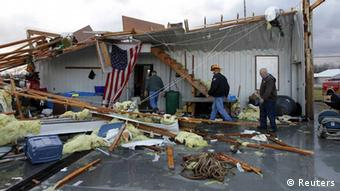 Members of the Milton Fire department work to clear storm damage after a tornado hit the fire house in Milton, Kentucky March 2, 2012. A series of tornadoes tore through the U.S. midsection on Friday, killing at least four people in the hard-hit state of Indiana, and blowing apart homes and flattening buildings across the region. REUTERS/John Sommers II (UNITED STATES - Tags: DISASTER ENVIRONMENT) // eingestellt von se