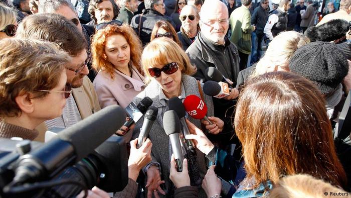 Survivor Patrizia Bagnasco (C) talks to journalists as she arrives at Moderno Theatre for the opening pre-trial hearing for the cruise liner Costa Concordia disaster in Grosseto March 3, 2012. Legal teams and relatives of victims of the capsized Costa Concordia began arriving at the theatre in the Tuscan town of Grosseto on Saturday, where the pre-trial hearing will begin to investigate the tragedy. Prosecutors have accused captain Francesco Schettino of causing the accident by sailing the multi-storey Costa Concordia too close to the Mediterranean island of Giglio in January, where it was torn open by rocks. He is accused of a string of charges including multiple manslaughter and abandoning ship before the evacuation of more than 4,200 passengers and crew. REUTERS/Giampiero Sposito (ITALY - Tags: MARITIME DISASTER MEDIA CRIME LAW)