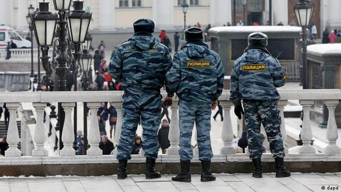 Russian police officers patrol in Manezh Square in downtown Moscow, Russia, Saturday, March 3, 2012.