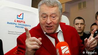 Leader of the Liberal Democratic Party of Russia (LDPR) and presidential candidate Vladimir Zhirinovsky speaks to media after voting at a polling station in Moscow (Reuters)