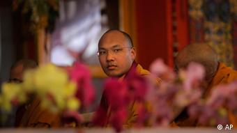 Tibetan Buddhism's third most important leader Ugyen Thinley Dorje, the 17th Karmapa, attends a teaching session of the Dalai Lama during the Kalachakra Buddhist festival in Bodh Gaya, Bihar state, India, Sunday, Jan. 8, 2012. Bodh Gaya, is believed to be the place where Buddha attained enlightenment. (AP Photo/Altaf Qadri)