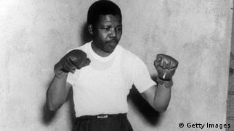 The young Mandela in boxing pose in 1950