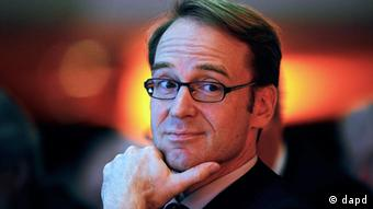 Weidmann looks sideways, with his chin resting on his left hand