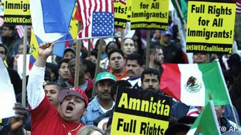 Demonstrators wave flags and display signs during an immigration-rights rally in Boston, Monday, April 10, 2006. (ddp images/AP Photo/Steven Senne)