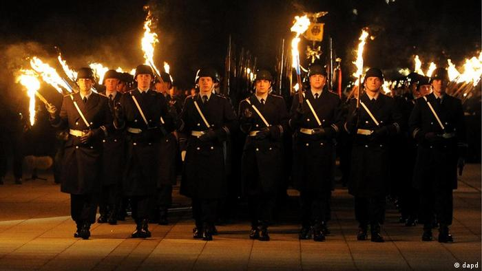 Bundeswehr soldiers carrying torches during the military parade for former Defense Minister Karl Theodor zu Guttenberg