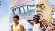 Two girls walk past a street mural with a painting of Colombian writer Gabriel Garcia Marquez, in Aracataca, Colombia, Wednesday, Jan. 4, 2006. The Literature Nobel Prize-winner, also known as Gabo, is turning 80 years old Tuesday, March 6, 2007. (ddp images/AP Photo/Fernando Vergara)