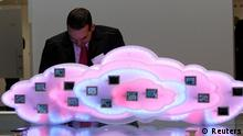 A staff member checks display to demonstrate cloud computing with mobile phones at the booth of German company Deutsche Telekom during preparations at the CeBit computer fair in Hanover, March, 5, 2012. The biggest fair of its kind open its doors to the public on March 6 and will run to March 10, 2012. REUTERS/Fabrizio Bensch (GERMANY - Tags: BUSINESS TELECOMS SCIENCE TECHNOLOGY)
