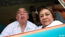 Colombia's Literature Nobel Prize winner Gabriel Garcia Marquez, sticks out his tongue to photographers upon his arrival on a train to Aracataca, his hometown in northeastern Colombia, Wednesday, May 30, 2007. At right is his wife Mercedes Barcha who accompanied the writer on his first visit to his hometown in 25 years. (ddp images/AP Photo/William Fernando Martinez)