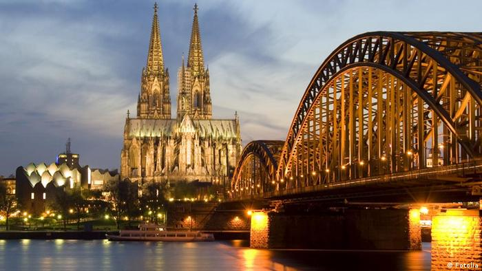 Germany, Cologne Cathedral seen from across the river at night