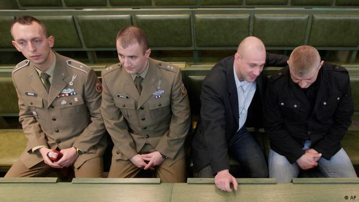 Four of seven Polish officers who were acquitted last year in the shelling of an Afghan village sit in court as their case is heard on appeal by Poland's supreme court