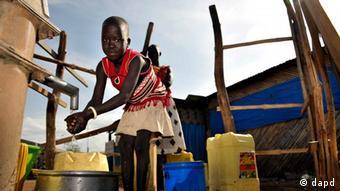 Girl washin her hands in Sudan