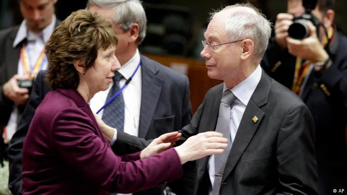 European foreign policy chief Catherine Ashton, left, speaks with European Council President Herman Van Rompuy during a round table meeting at an EU summit in Brussels on Friday, Oct. 29, 2010. EU leaders on Friday agreed on tougher rules for spendthrift nations whose overspending threatens Europe's single currency and risks triggering a debt crisis. (AP Photo/Yves Logghe)