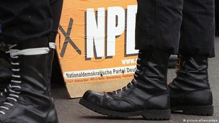 Boots of NPD members in front of party poster