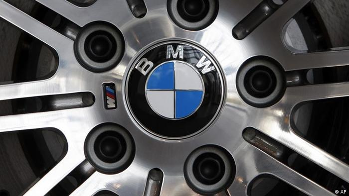 FILE - In this March 18, 2009 file photo a BMW logo is photographed on a wheel of a BMW car prior the annual balance press conference in Munich, southern Germany. BMW said Thursday, March 8, 2012, it increased net profit by 51 percent last year to euro 4.9 billion (US dollar 6.43 billion) as it benefitted from strong demand for its luxury cars and SUVs in China and an economic recovery in the United States. Revenues rose 14 percent to euro 68.82 billion, as the number of cars and SUVs sold in China increased 38 percent to 233,600. Sales rose 14 percent in the United States, where the company sold more than 340,000 vehicles. (Foto:Matthias Schrader, File/AP/dapd)