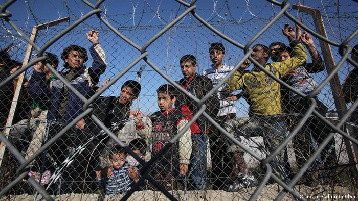 Illegal immigrants behind a fence in Greece