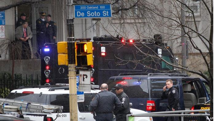 Police gather on DeSoto street near the front entrance to the Western Psychiatric Institute and Clinic on the University of Pittsburgh campus, Thursday, March 8, 2012 in Pittsburgh.