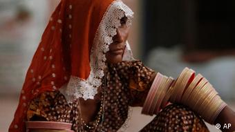 A Pakistani flood survivor from Hindu community takes refuge in a temple in Thatta near Hyderabad, Pakistan on Saturday, Aug. 28, 2010 (ddp images/AP Photo/Shakil Adil)