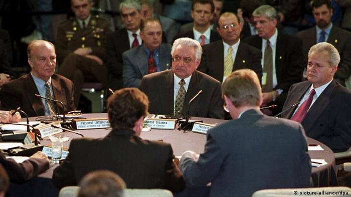 Bosnian President Alija Izetbegovic (L), Crotian President Franjo Tudman (C), and Serbian President Slobodan Milosevic listen to US Secretary of State Warren Christopher (not seen) 01 November during the start of the Proximity Peace Talks at Wright Patterson Air Force Base near Dayton, Ohio.