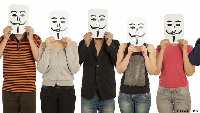 Group people with the painted Guy Fawkes. Andre - Fotolia 38803490