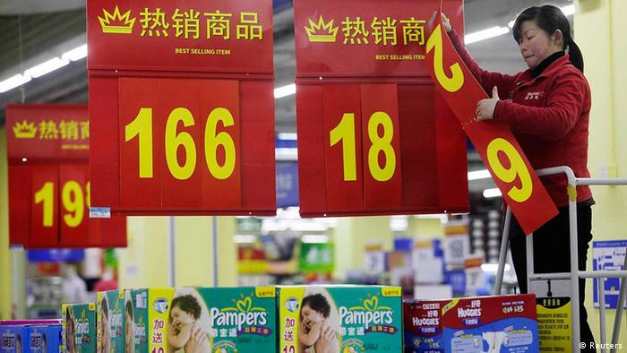 An employee changes a price label at a supermarket in Wuhan, Hubei province March 9, 2012. China's annual inflation cooled sharply to a 20-month low of 3.2 percent in February as food price pressures eased after the Lunar New Year holiday, giving Beijing room to loosen monetary policy if needed. REUTERS/Stringer (CHINA - Tags: BUSINESS FOOD) CHINA OUT. NO COMMERCIAL OR EDITORIAL SALES IN CHINA