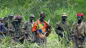 ** FILE ** Members of Uganda's Lord's Resistance Army are seen as their leader Joseph Kony meets with a delegation of Ugandan officials and lawmakers and representatives from non-governmental organizations, on July 31, 2006 in the Democratic Republic of Congo near the Sudanese border. The Lord's Resistance Army is made up of the remnants of a rebellion that began in 1986. The rebels are accused of attacks on civilians and aid workers in neighboring Congo and Sudan, where they sought refuge as the Ugandan army gained an upper hand in northern Uganda. (AP Photo) ** zu unserem Korr **