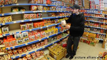 A man shops for Asian food