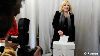 Slovakia's Prime Minister Iveta Radicova casts a ballot at a polling station during the parliamentary elections in the village of Nova Dedinka, about 20 km (12 miles) from Bratislava, March 10, 2012. REUTERS/Radovan Stoklasa (SLOVAKIA - Tags: POLITICS ELECTIONS)
