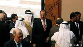 Russia's Foreign Minister Sergei Lavrov (C) attends the Arab League foreign ministers meeting at the organization's headquarters in Cairo March 10, 2012. REUTERS/Asmaa Waguih (EGYPT - Tags: POLITICS)