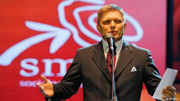Robert Fico, leader of Slovakia's most popular social democratic political party Smer, speaks during the party pre-election rally in Bratislava, March 8, 2012. Slovakia's center-right coalition leaders face electoral humiliation on Saturday at the hands of voters angry at a major corruption scandal, returning to power a left-wing, pro-European party that promises to tax the rich. REUTERS/Petr Josek (CZECH REPUBLIC - Tags: POLITICS ELECTIONS)